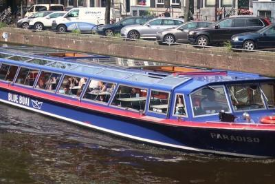 Amsterdam canal cruise blue boat