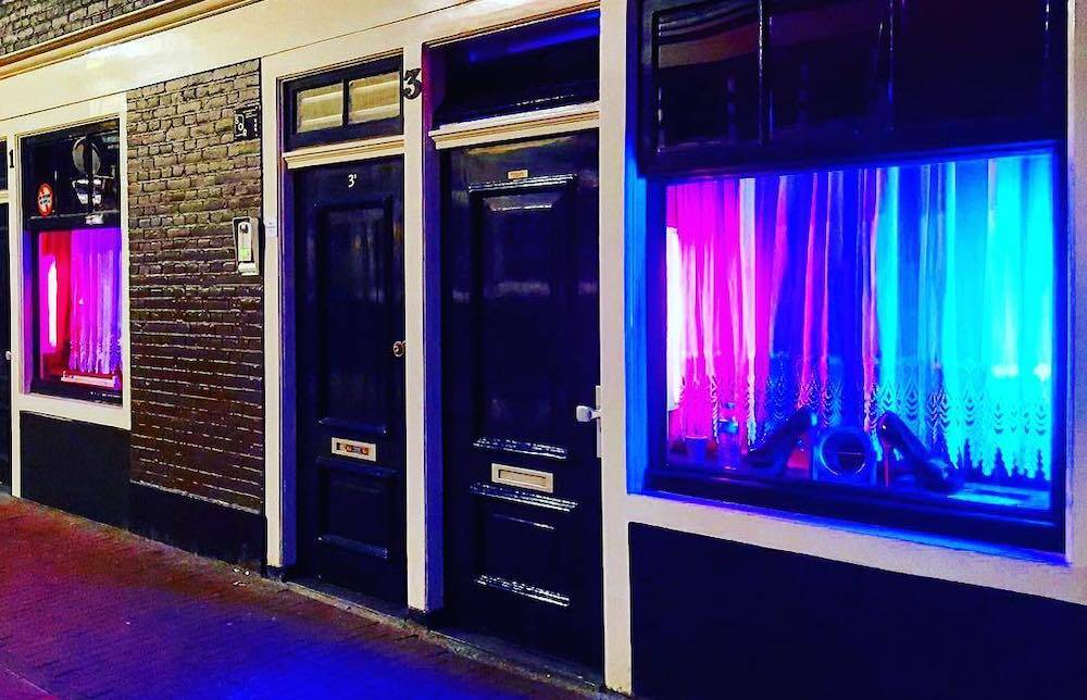 a red light area in amsterdam with blue glass